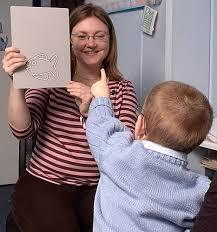 A young child points towards the image on the Cardiff Card